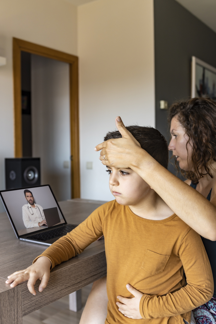 Worried Mother Video Chatting With Doctor On Laptop